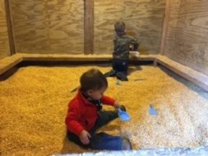 Children Playing in Corn Box